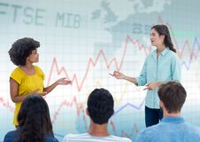 Woman speaking with audience against blue graph Stock Images