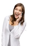 Woman speaking on cell phone. Half-length portrait of woman speaking on cell phone, isolated on white Royalty Free Stock Images