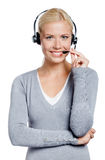 Woman speaking on the earphone Royalty Free Stock Photo