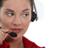 Woman speaking into her headset Stock Photography