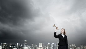 Woman speaking in horn Stock Image