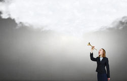 Woman speaking in horn Stock Photography