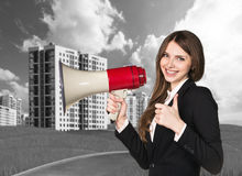 Woman speaking in megaphon Royalty Free Stock Photography
