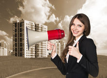 Woman speaking in megaphon Stock Images