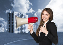 Woman speaking in megaphon Royalty Free Stock Photo
