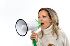 Woman speaking through megaphone Royalty Free Stock Photos