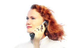 Woman speaking mobile phone. Romantic  young woman with red hair and mobile phone, isolated on white Royalty Free Stock Image