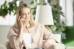 Woman speaking with mobile phone Stock Photography
