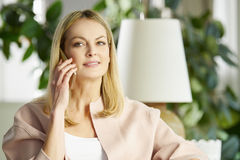 Woman speaking with mobile phone Stock Photos
