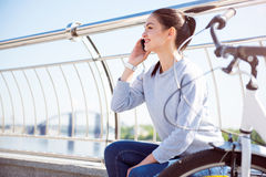 Woman speaking on the mobile phone Stock Photo