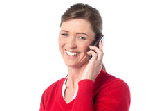 Woman speaking over cellphone Stock Photos
