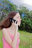 Woman speaking the phone Stock Photos