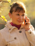 The woman speaking by phone Royalty Free Stock Photos