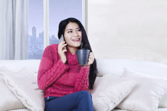 Woman speaking by phone in the apartment Royalty Free Stock Photo