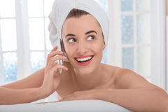 Woman speaking phone in the bathroom or spa salon Royalty Free Stock Photography