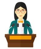 Woman speaking on podium Royalty Free Stock Images