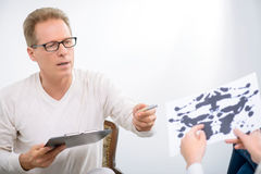 Woman speaking with psychologist Stock Image