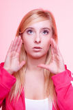 Woman speaking, young girl whispering over pink Royalty Free Stock Photos
