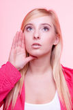 Woman speaking, young girl whispering over pink Stock Photos
