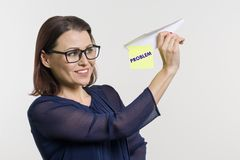 A woman speaks and lets her problems with a paper abstract airplane. stock images