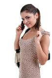 Woman speaks by a mobile phone Royalty Free Stock Photos