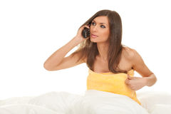 Woman speaks by a mobile phone Stock Photography