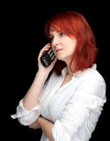 Woman speaks by a mobile phone Royalty Free Stock Photography