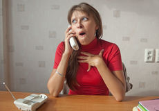 The woman speaks on the phone Stock Photo