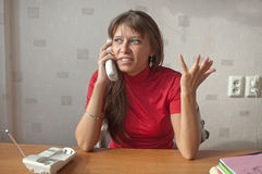The woman speaks on the phone Royalty Free Stock Photo