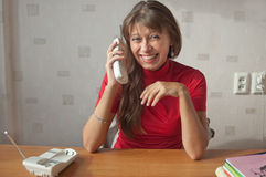 The woman speaks on the phone Stock Images