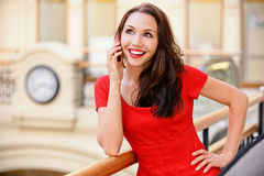Woman speaks by phone Stock Image