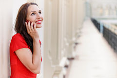 Woman speaks by phone Stock Images