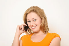 Woman speaks on the phone Royalty Free Stock Images