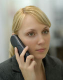 Woman speaks on the phone. The young beautiful fair-haired woman speaks by phone Royalty Free Stock Image