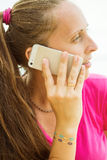 Woman speaks on the phone. Woman's Hand with sticker tattoos. Royalty Free Stock Image