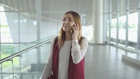 Woman speaks on smartphone while boarding on plane Royalty Free Stock Photo