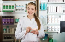 Woman specialist in apothecary. Portrait of  friendly specialist working in apothecary Stock Image