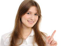 Woman specifying top  at copy space. Young woman specifying top  at copy space on a white background Stock Photos