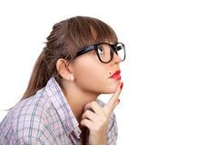 Woman in spectacles. Profile of the young woman in spectacles, it is interested looking, having put a finger on a chin Stock Photo