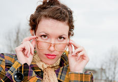 Woman in spectacles on a walk in the park Royalty Free Stock Image