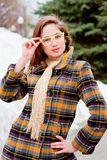 Woman in spectacles on a walk in the park. Beautiful young woman in spectacles on a walk in the park Stock Photo