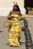 Woman in spectacular yellow dress Havana royalty free stock photo