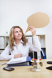 Woman with speech balloon in office Stock Photo