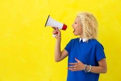 Woman speeking in megaphone. Woman speaking in megaphone loudly Stock Photography