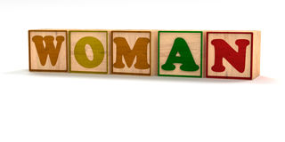 Woman Spelled Out in Child Wood Blocks Royalty Free Stock Image
