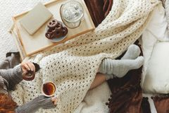 Woman spending night in bed. Young woman spending a cold night in bed with blanket Stock Images