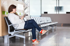 Woman spending time in airport lounge Stock Photos