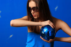 Woman with sphere. Blue background Stock Images