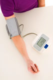 Woman with sphygmomanometer Royalty Free Stock Image