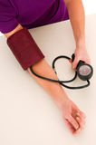Woman with sphygmomanometer Stock Photography
